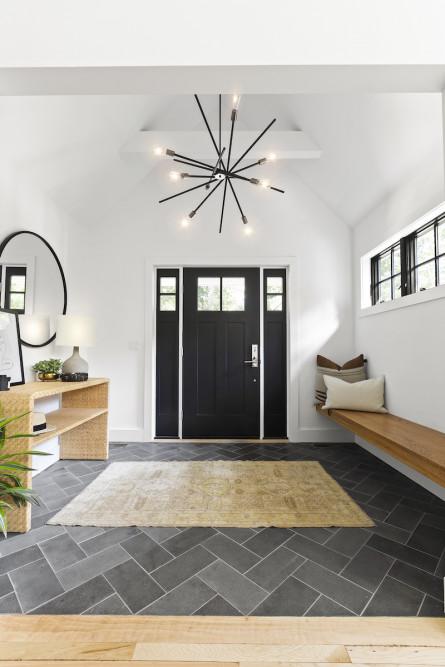 entryway-herringbone-tile-floor-black-door